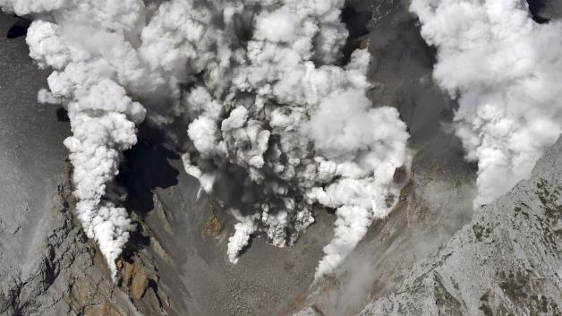 Dense fumes are spewed out from several spots on the slope of Mt. Ontake as the volcano erupts in central Japan, Sept. 27, 2014.